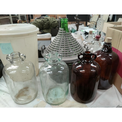 46B - A large selection of wine making equipment including 12 demijohns etc