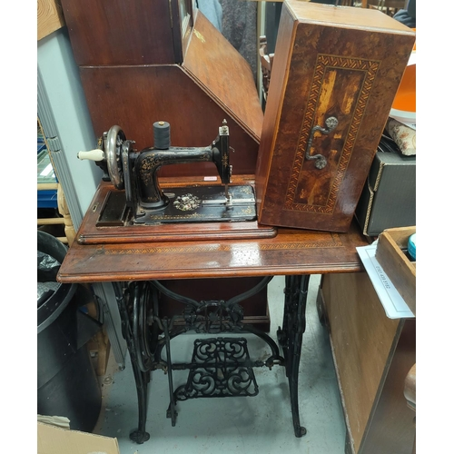 93 - A 19th century treadle sewing machine by Seidel and Naumann, with ornate cast iron base, 74 cm