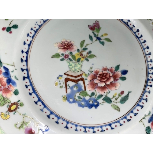 307A - A Chinese 19th century plate with central polychrome floral arrangement and floral border and fluore...