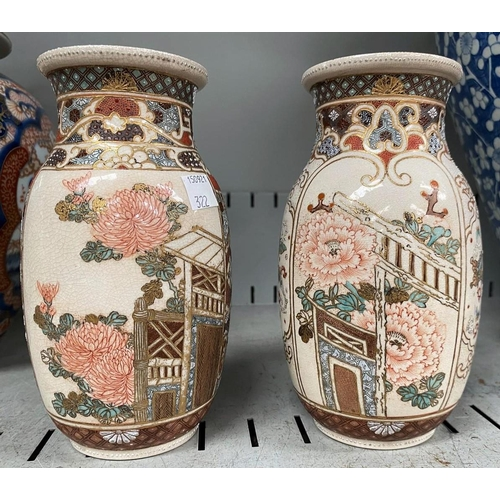 322 - A pair of Japanese Satsuma vases with floral decoration, ht. 18cm (in good condition, gilt line to r...