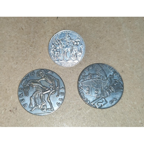 130B - Two World War 1 period German medallions and a similar period Drei Mark coin made into a brooch
