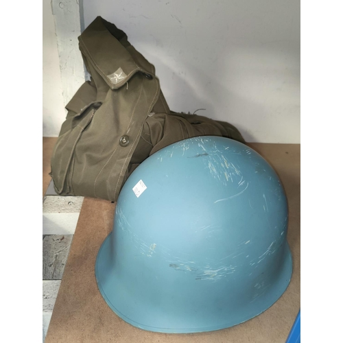 130D - An Italian tin helmet and a soldiers jacket