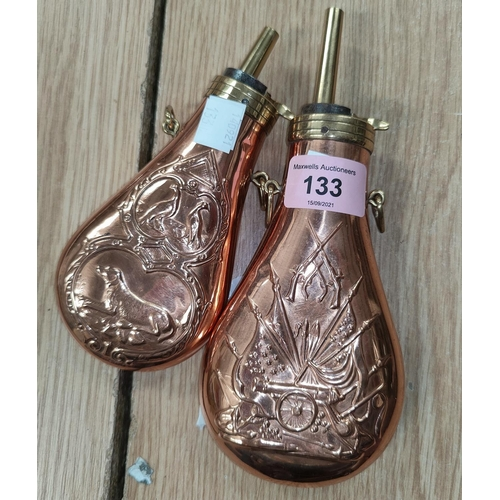133 - A brass mounted copper flask American style embossed decoration, 20cm and another similar, 16cm