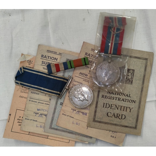 149 - A GVI Police Long Service and Good Conduct medal to SERGT. James Mitchell, a WWII medal and contempo...