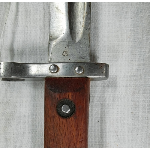153 - A Bayonet with wood sides to the handle, steel Scabbard; blade 24cm.