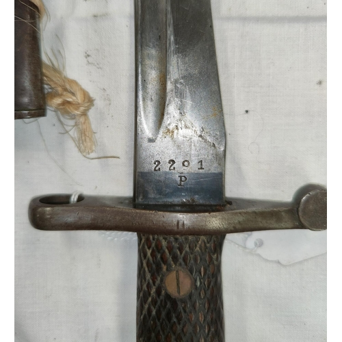 156 - A Spanish 1941 pattern Bolo Bayonet, with cross hatched wooden sides to the handle, steel Scabbard; ...