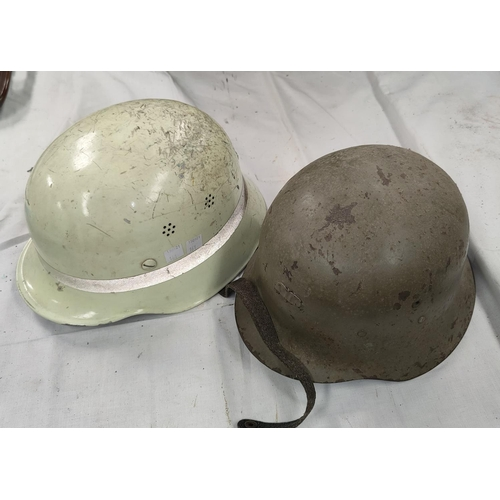 161 - A German style steel Helmet, leather and canvas lining and anothe similar.