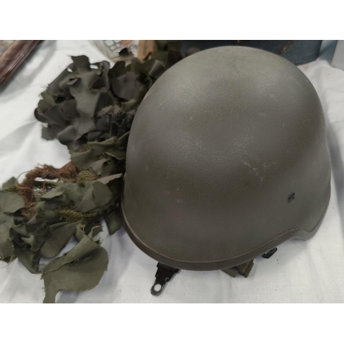 162 - A modern combat composition helmet and camouflage cover.