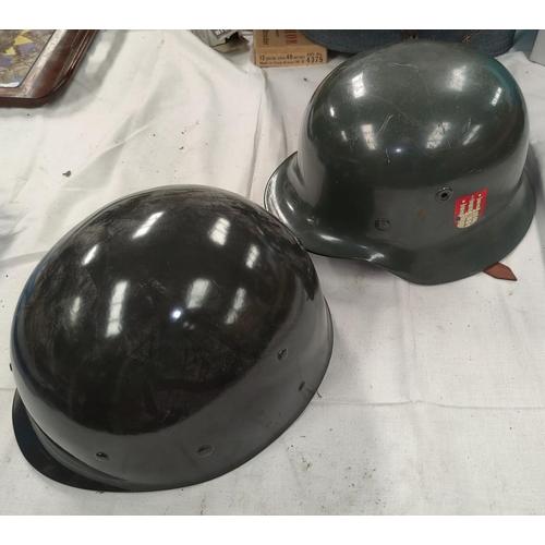 163 - A German style steel helmet, leather lining and a plastic helmet.