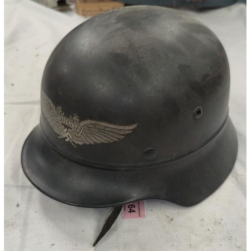 164 - A German style steel helmet, leather lining, bears Luftschutz transfer.
