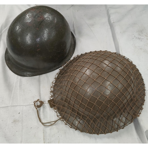 165 - A British pattern steel helmet with webbing and a helmet shell.