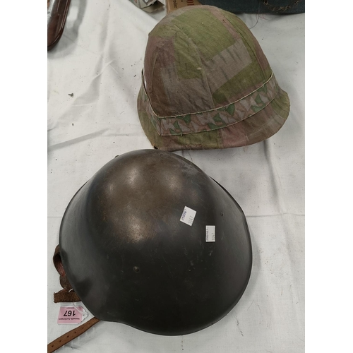 167 - A steel combat helmet with leather and nylon lining, another helmet with a canvas camouflage cover.