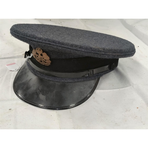 169 - A mid 20th century Royal air Force cap with a brass badge, dated 1952