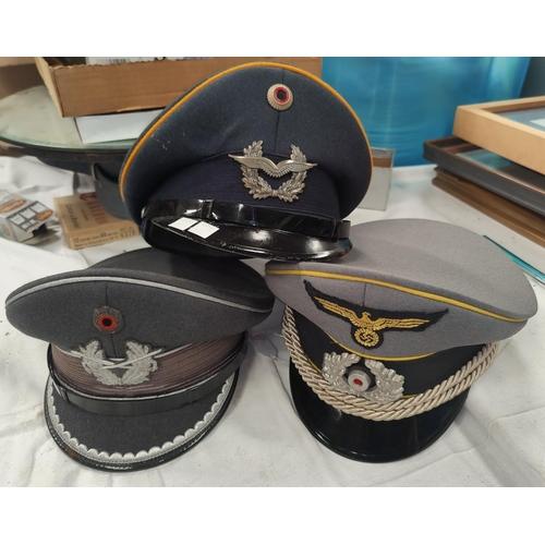 170 - Three reproduction German military caps.