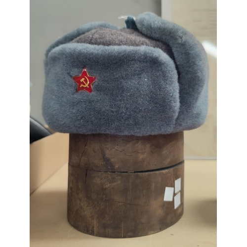 171 - A Russian Soviet era, lined wool hat with enamel badge and an old pine hat mould.