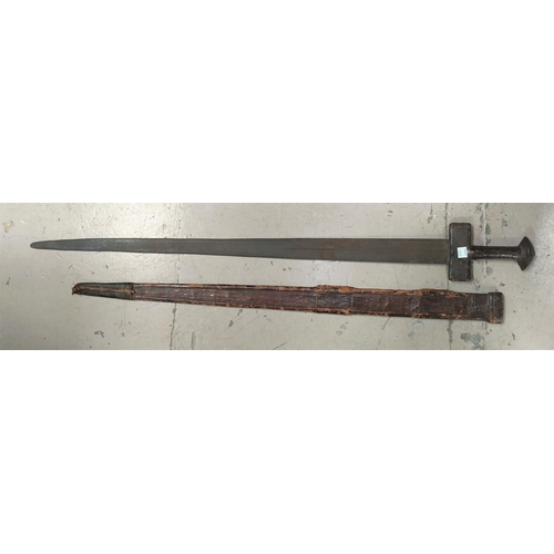 179B - A 19th century Mid Eastern/Sudanese sword in embossed leather scabbard, overall length of sword 97cm
