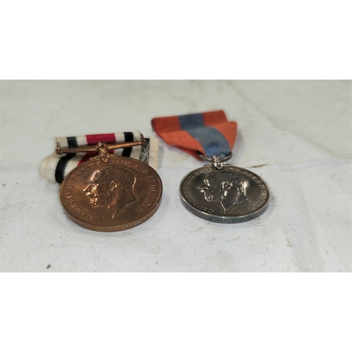 186 - A GV Imperial Service Medal to Isaac Parker and a GV Special Constabulary Medal to Hubert E. Wrighto...