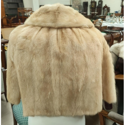 42D - A short honey mink jacket with 3/4 length sleeves, size 12 / 14