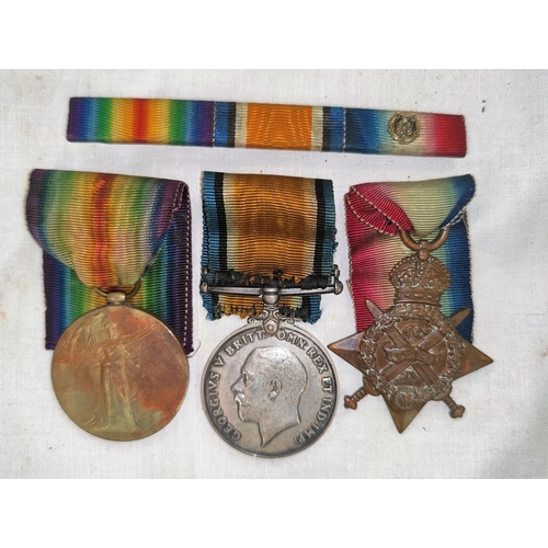 195 - A WWI 1914 Star and bar trio of medals to L-15076 Pte C.I. SHARPE, 1/R. FUS with medal bar and roset...