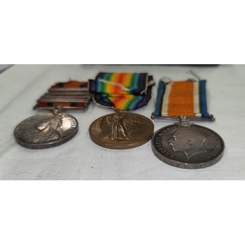 198 - A Boer War/WWI family group of three medals comprising of a QSA 4 clasps to 7925 SGT. C. BLAKE 40TH ...