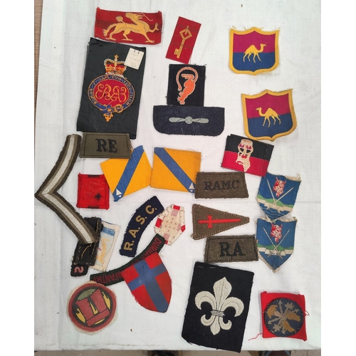 200 - A collection of British army cloth badges