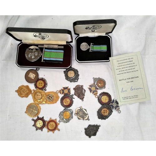 203 - A selection of mid 20th century shooting medals and a Battle of Britain medal and miniature