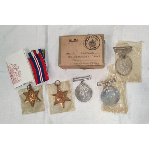 206 - A GVI Territorial Efficiency medal to 2085861 SJT.A.C. GARDNER R.A. and a group of 4 WWII medals