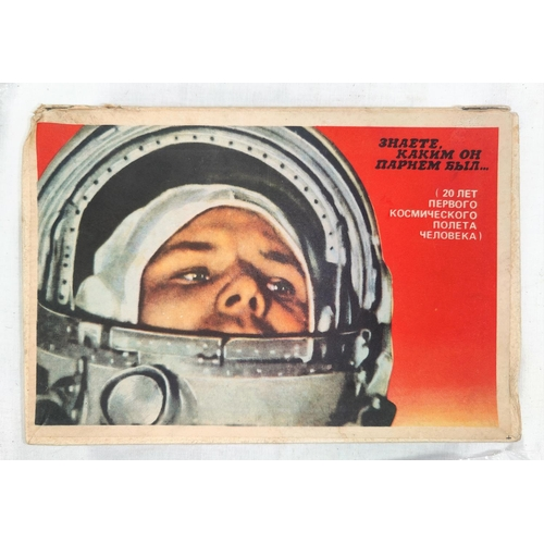 217A - SOVIET COSMONAUTS: a large matchbox paper over wood with a photograph of Yuri Gagarin and 23 similar...