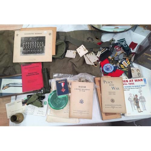 224C - A collection of militaria items to include postcards, ephemera, photos, trenchart, badges and button...