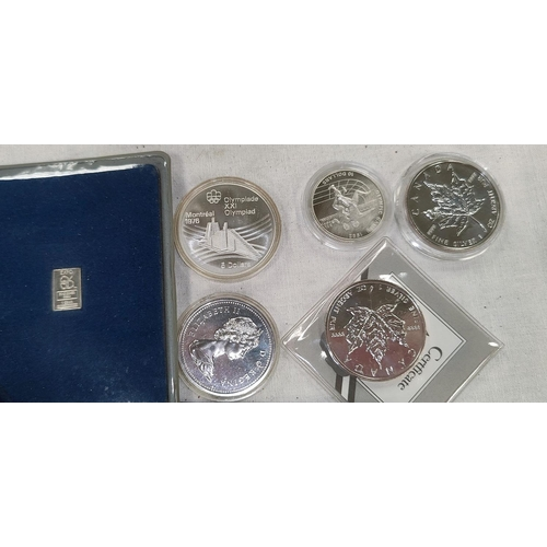 236 - CANADA: 2 X 1992 Maple Leaf silver coins, an Olympics $5 1976 anothe dollar 1975, 2 other items