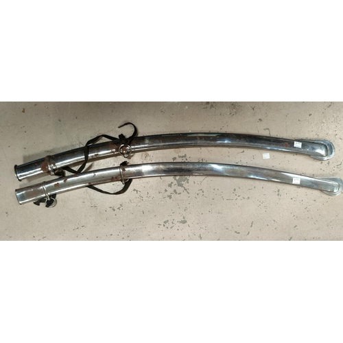 219A - Two 19th Century polished steel naval longer sword scabbards, 85cm