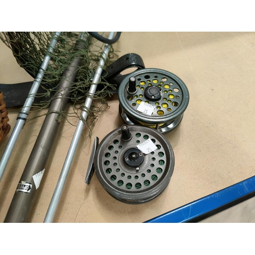 25 - Four various fishing rods:  Olympic; Shakespeare; RYOBI; etc.; a fishing creel with 2 fly reels; etc...