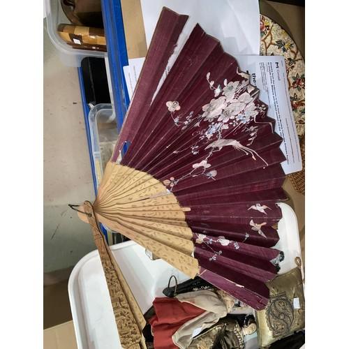 32 - A Victorian black silk parasol; a selection of fans; 2 19th century cloth dolls; a pin cushion