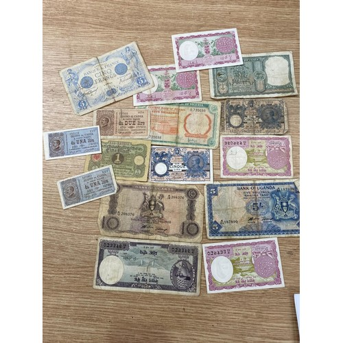 130C - A selection of World coins of different periods, an early German bank note and other similar notes