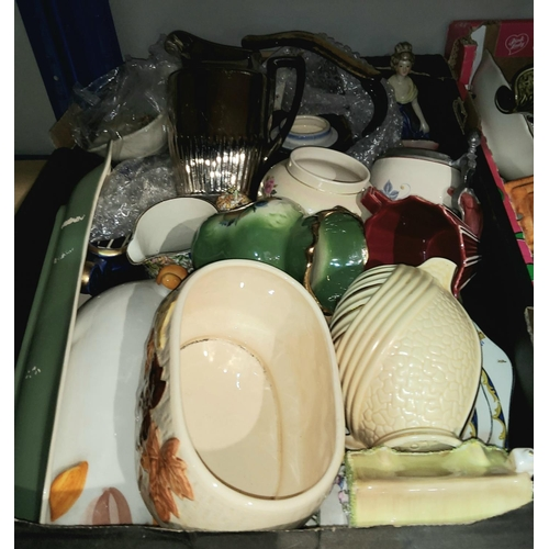 12 - A selection of decorative pottery including Royal  Doulton tureens, Carlton ware dishes, Wade items ...