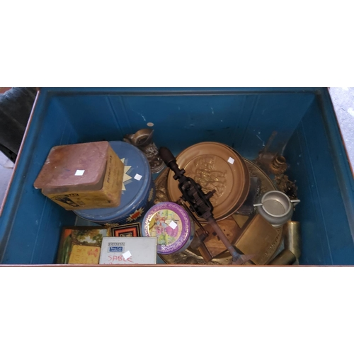 22 - A tin trunk and contents:  old tins; metal wire and collectables