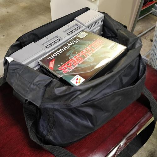 34 - Playstation 1 Games & Bag