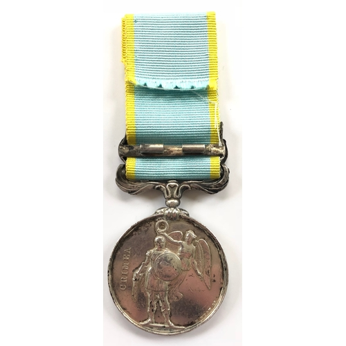 """31 - Crimea Medal, clasp """"Sebastopol"""" An unnamed as issued example. Remnants of hinge to reverse of clasp..."""