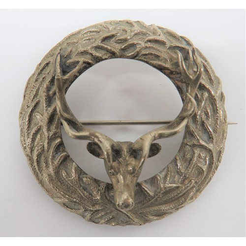 14 - Scottish Plaid Brooch cast white metal, circular disk with antler decoration. Central, overlaid, whi...
