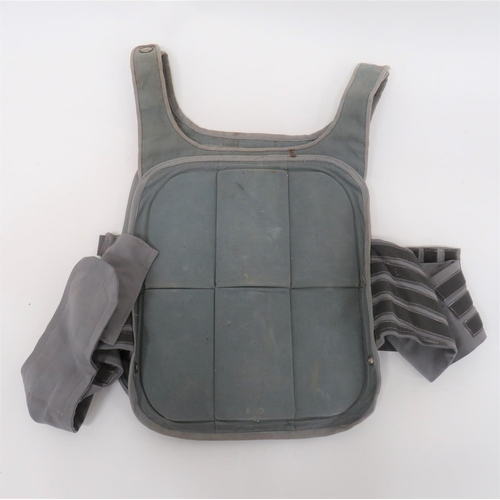 Post War Shrapnel Vest grey fabric front and rear panels, each with six internal steel sheets. Fabric shoulder straps secured by press studs. Waist, fabric straps with velcro fixing. Minor wear.