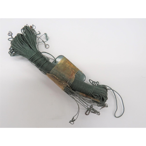 31 - RAF Escape and Evasion Fishing Kit consisting green coloured fishing line, wire line/hook attachment...