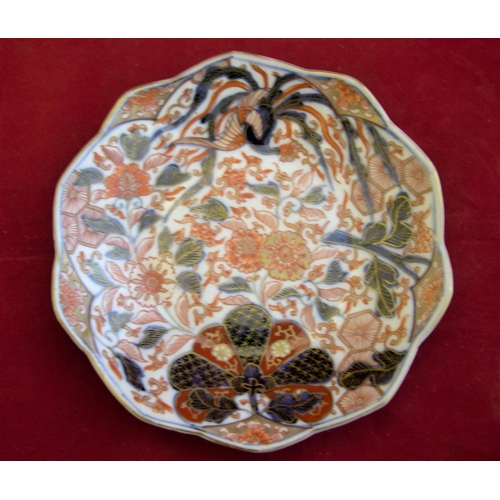 51 - 18thC unmarked, Chinese red & black circular plate with flower motif,...