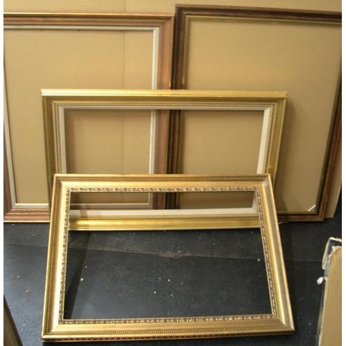 554 - 4 largish 20thC wood frames, inner 73 x 55 cm & 48 x 72 etc...