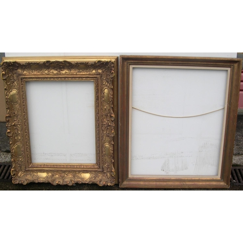559 - 2 medium sized mid/late 20thC quality frames, 1 wooden,  Internal measurements are - 61 x 52 cm & 47...