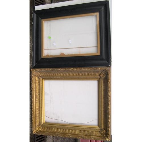 562 - 2 medium sized frames, 1 vintage, ebonised wood frame with glass & a modern frame,  Internal measure...