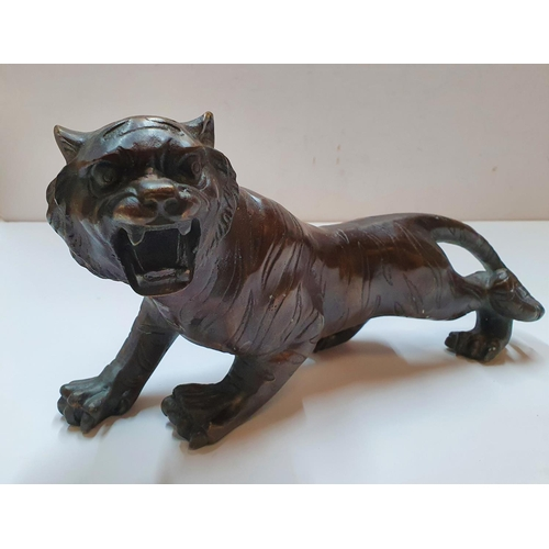 179 - Antique unmarked Chinese bronze tiger,  30 cm in length...