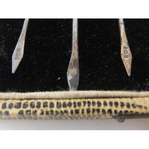 35 - 6 hallmarked silver and enamel cocktail sticks in original case  Good condition...
