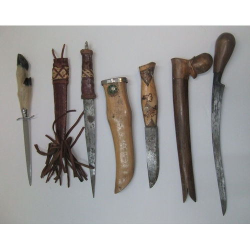 289 - 3 sheathed vintage knives (1 probably Inuit) & an old animals foot letter opener.  All appear in goo...