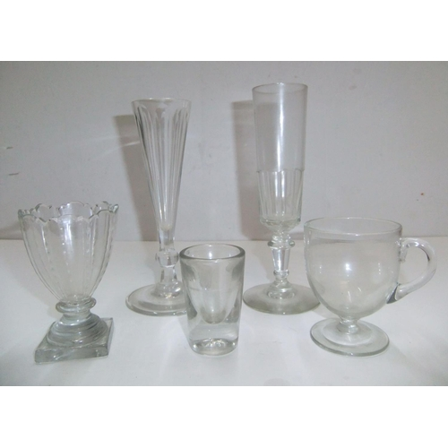 267 - Small collection of Victorian glassware to include 2 champagne flutes, a custard cup, shot glass etc...