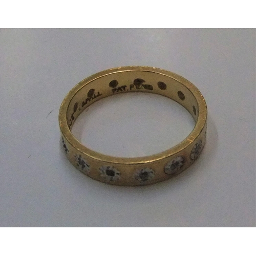15 - 18ct yellow gold eternity ring inset with 14 diamonds  Approx 3.7 grams gross,              size N...